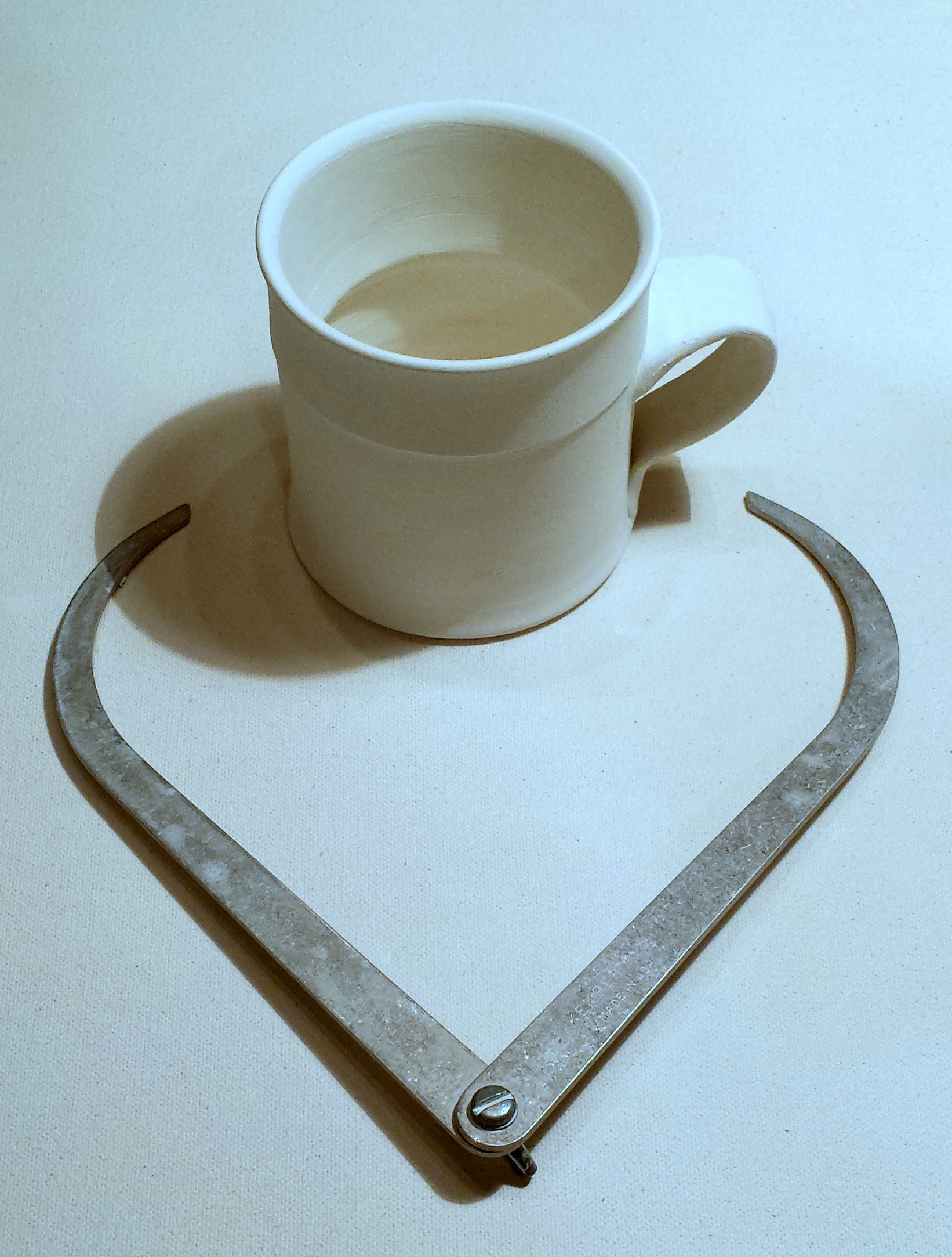 Anne studio coffee cup and measuring tool
