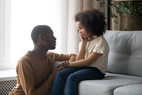 Loving african American father talk with