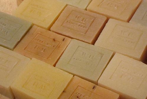 Bulk unpackaged olive oil soap.