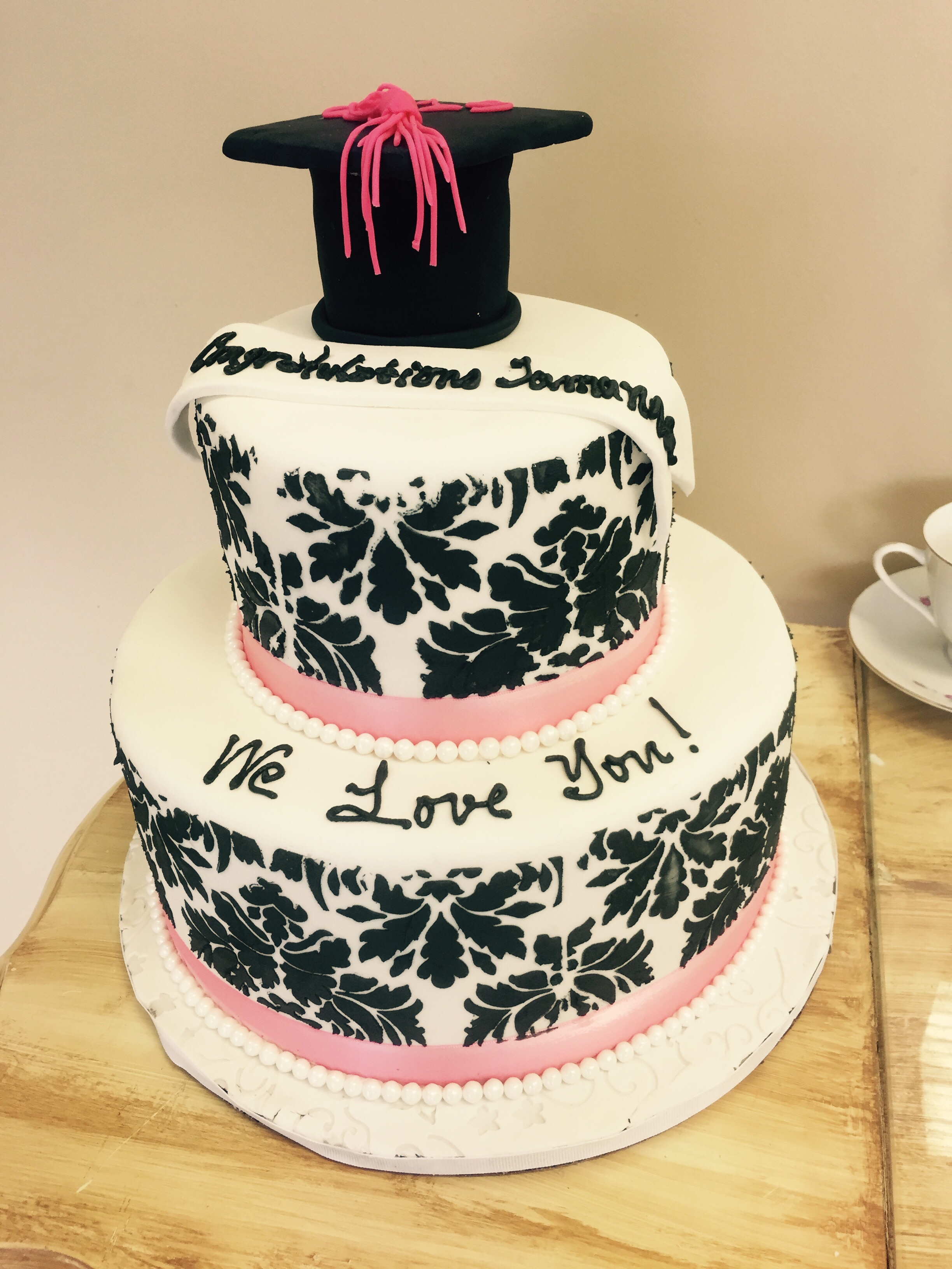 Pink and black graduation cake