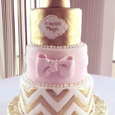 Princess pink and gold baby shower cake