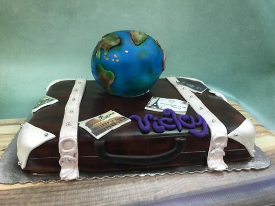 Luggage globe traveling birthday cake
