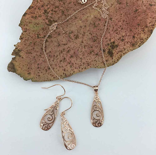 Rose Gold Plated necklace and matching earrings with Koru design