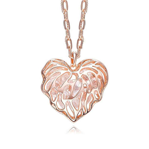 Organic heart shaped rose-gold necklace with caged crystals
