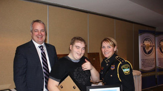 Deputy Minister Mike Comeau awards certificates of recognition