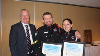 Deputy Minister Mike Comeau presents certificate