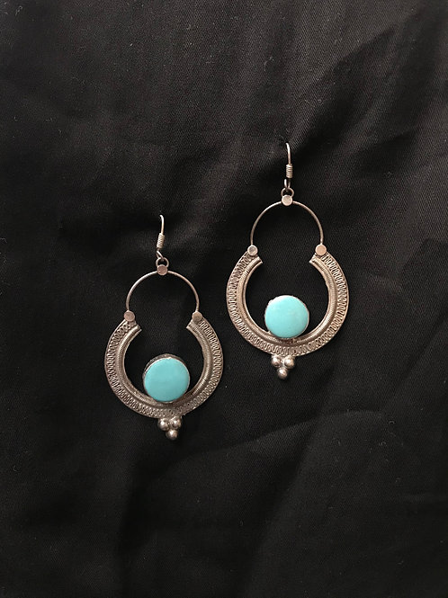 silver earing with turqoise stone