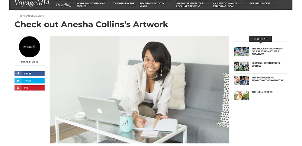 VoyageMIA Features Anesha Collins, African American female sitting on couch with a computer smiling. VOYAGEMIA