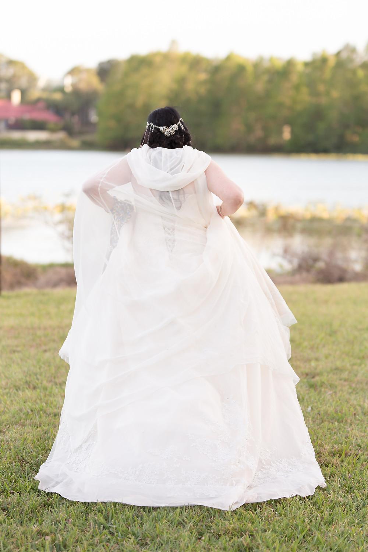 Chiffon Cloak on bride in grass.