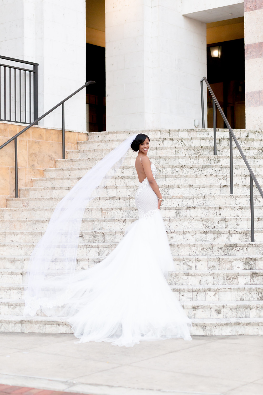 2019 Wedding Fashion Trends, Unashamed Imaging photography, Bride in gown with flowing veil on stairs