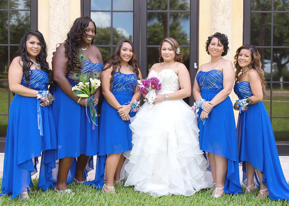 Bride with bridesmaids in orlando florida. Wedding couple in orlando florida at crystal ballroom veranda.