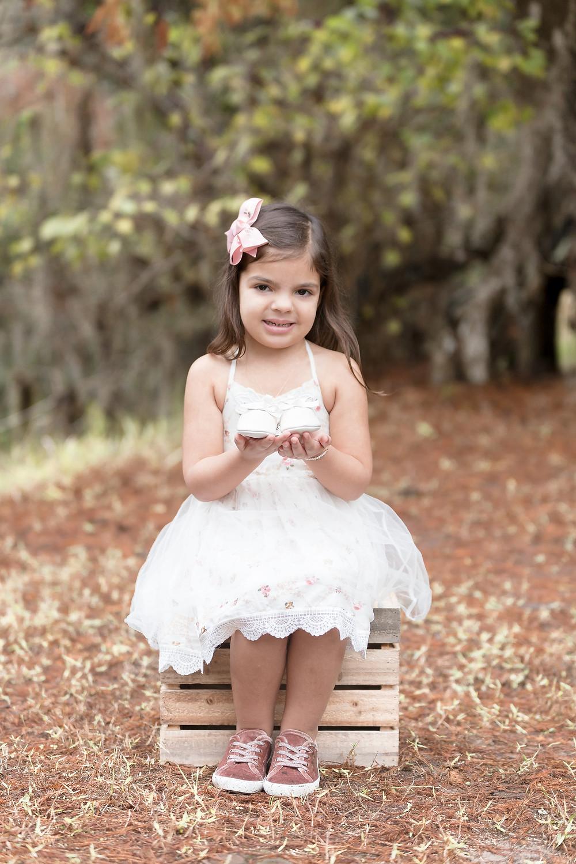 Little girl sitting on box for family mini session
