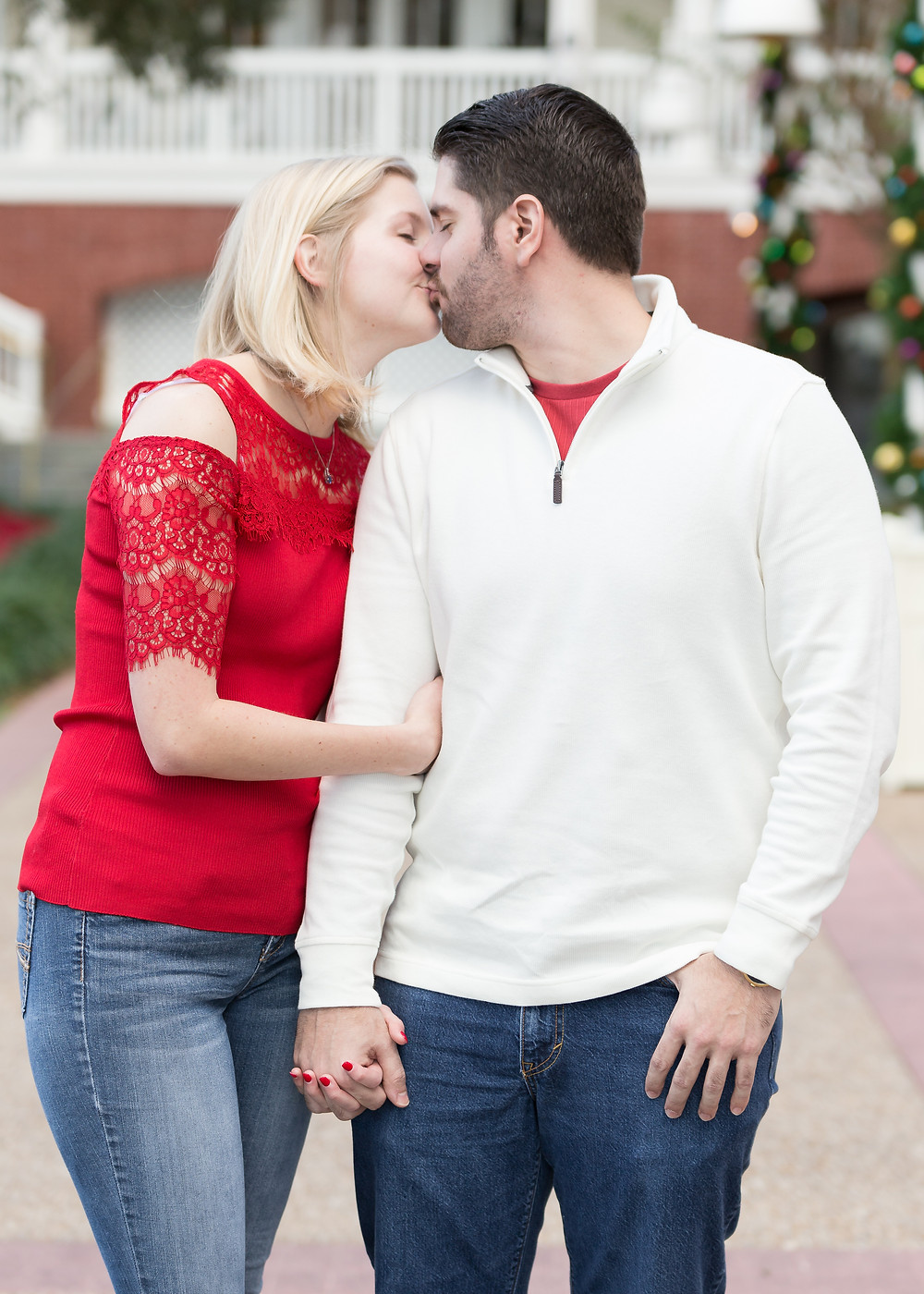 Couple kissing in red short in orlando photographer wedding.