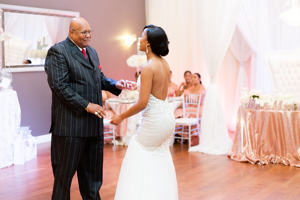 Bride dancing with her uncle at a wedding for first dance.