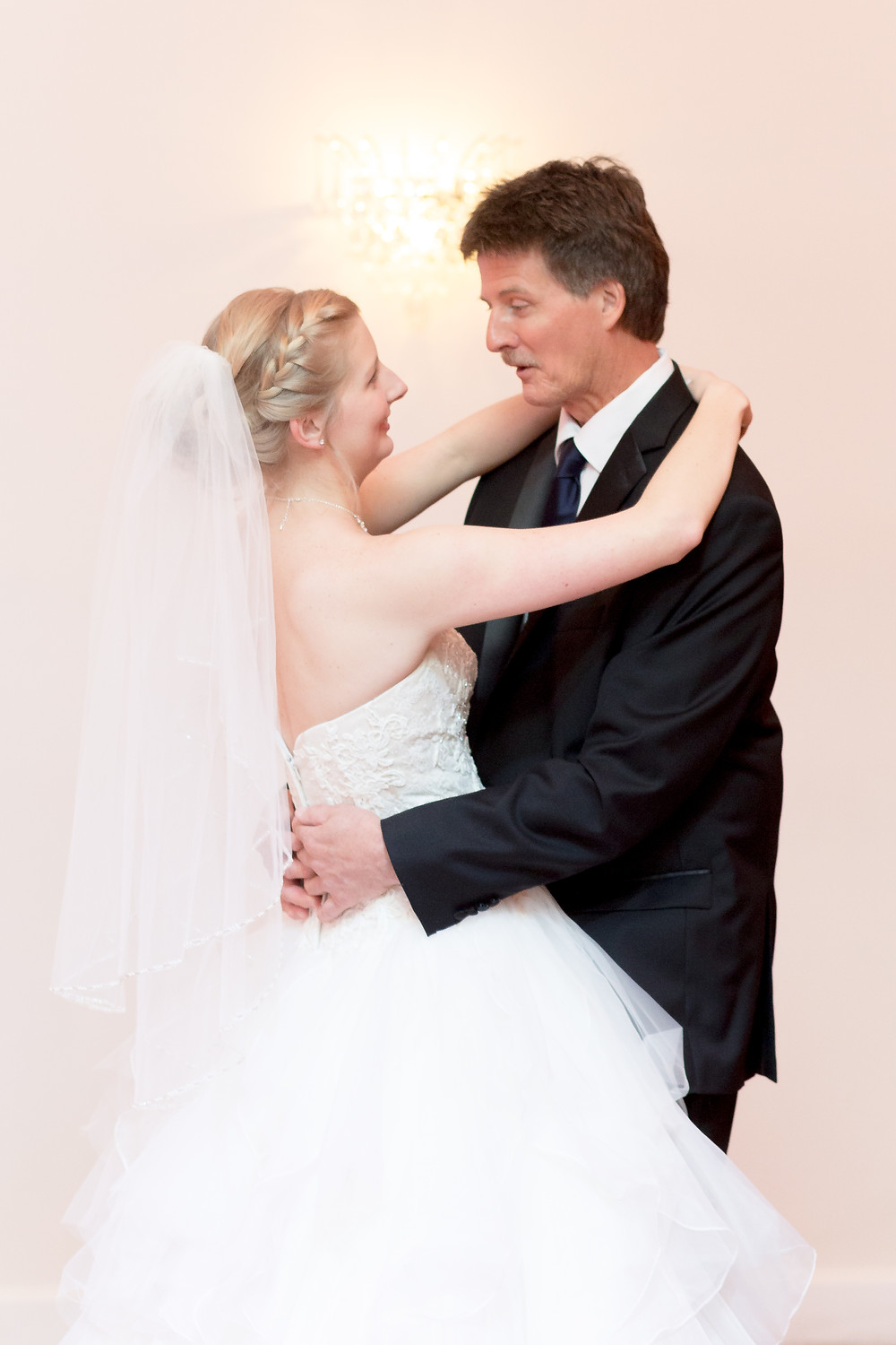 Bride dancing with her father at a wedding in white dress. Father-Daughter Dance Alternatives for Weddings.