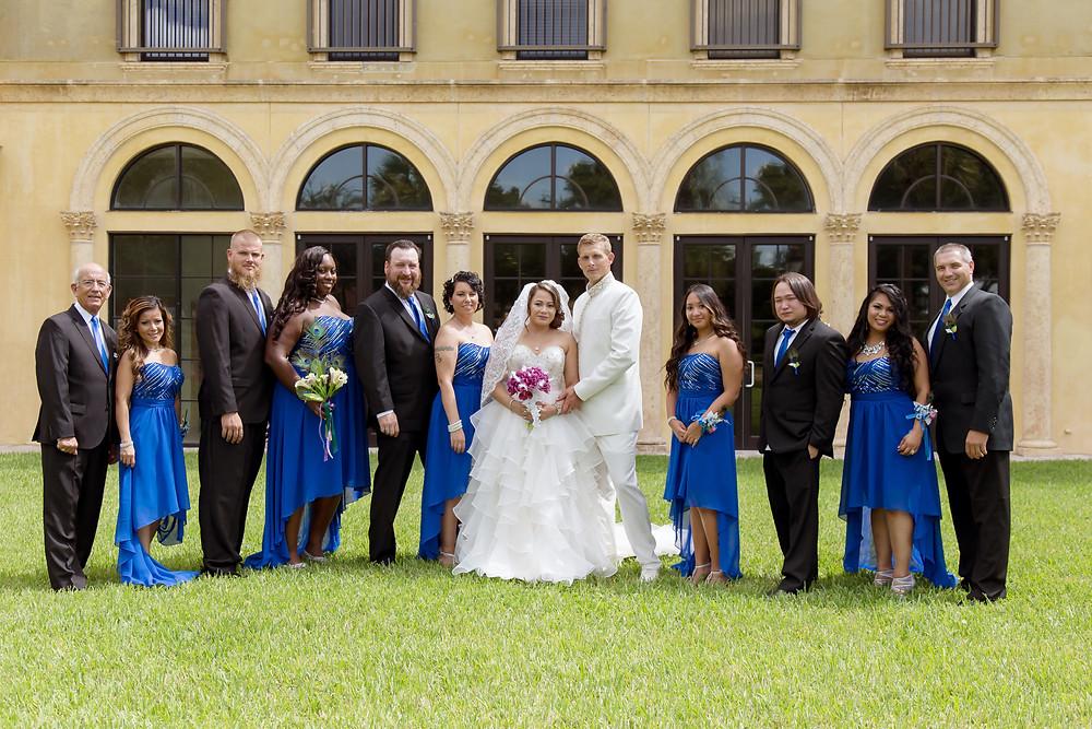 Wedding with blue bridesmaid dresses. Wedding couple in orlando florida at crystal ballroom veranda.