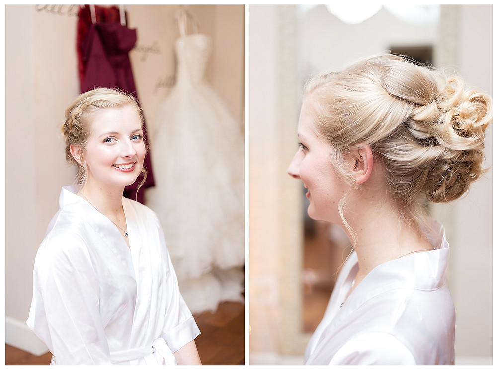 Bridal hair updo. Bride in white robe.