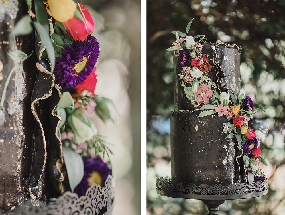 Flowers on a black wedding cake in a garden.