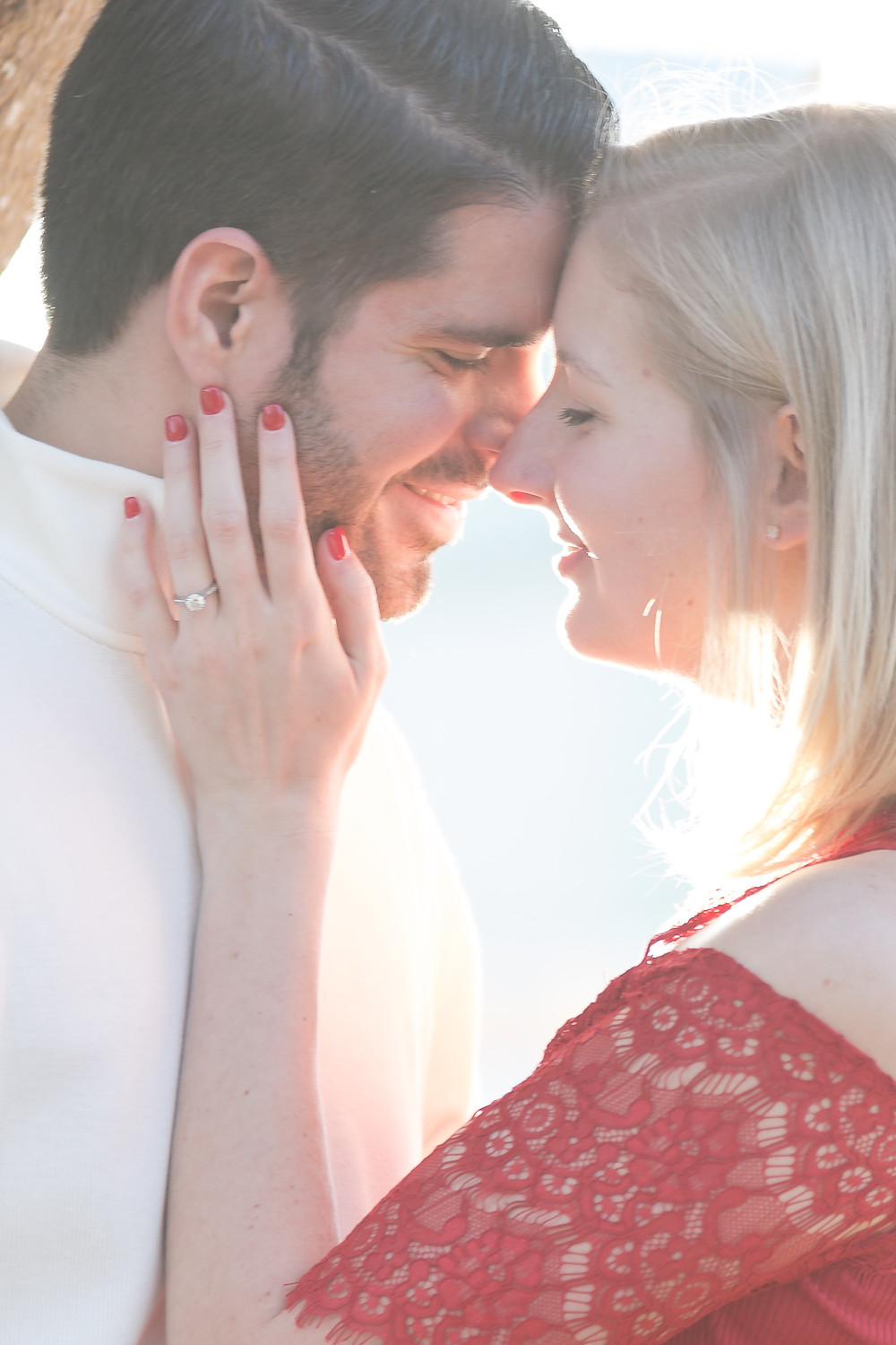 Couple kissing up close. Disney Boardwalk Engagement Session: Megan & Ryan