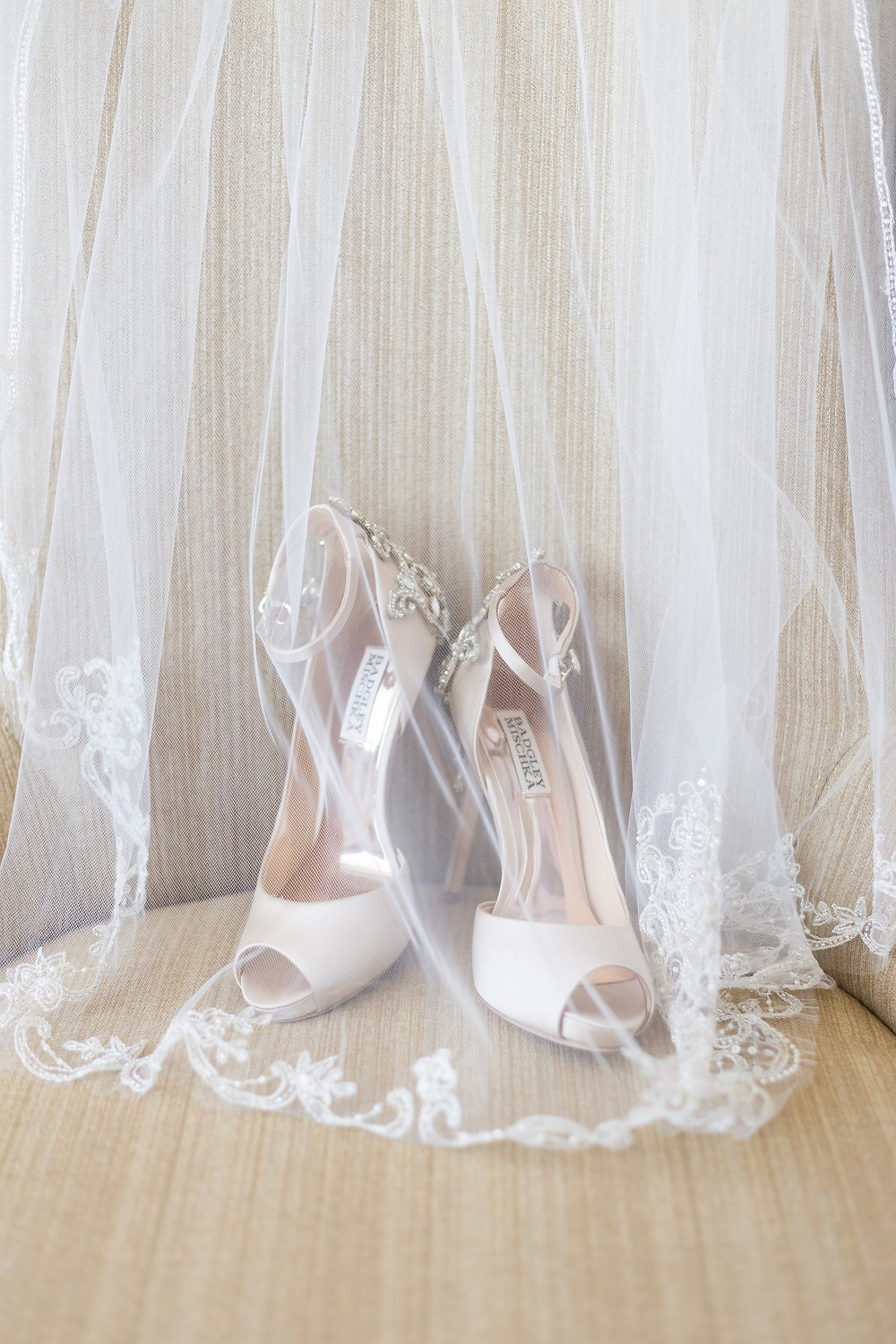 Bridal shoes for the wedding day with a veil.