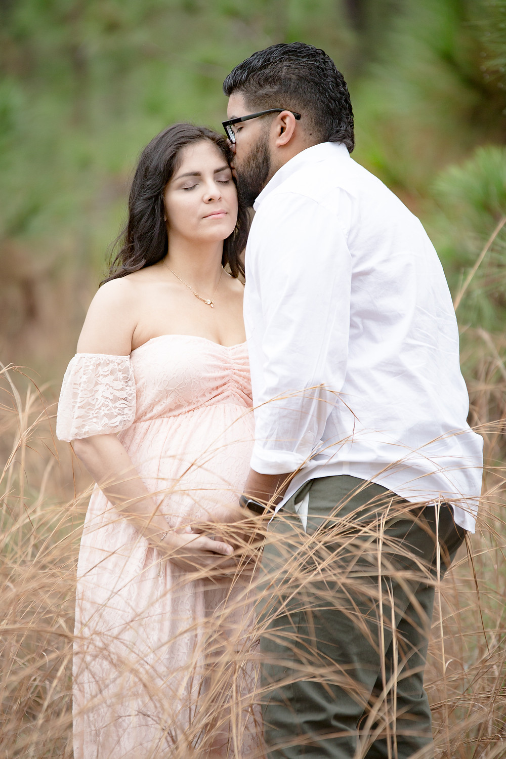 Husband hold pregnant wife belly