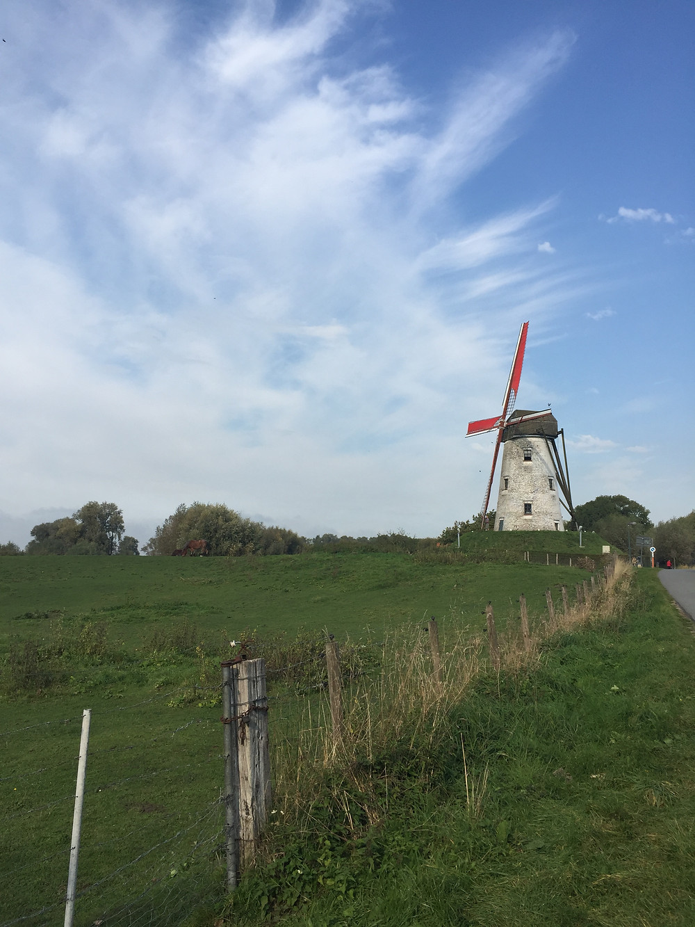 A windmill greets visitors at the edge of Damme, Belgium