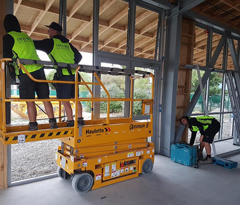 Scissor lift and workers