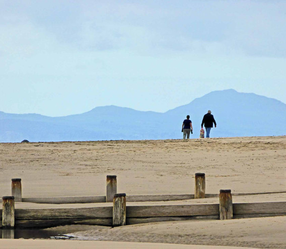 Walkers on Barmouth beach