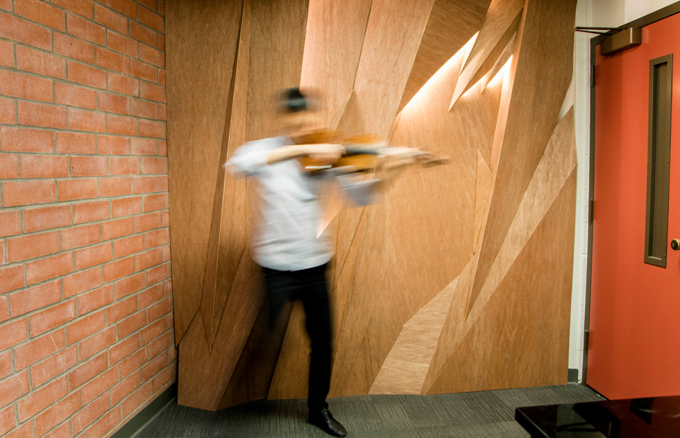 Placed onthe back wallof the music studio room, the wall provides sense of being on a stage and acoustical proximity for the students to understand the balance of sound.