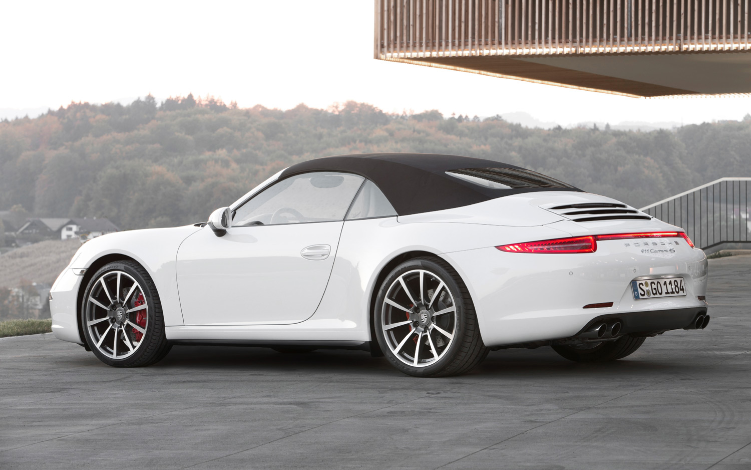 porsche 911 cabriolet - side- luxury car rental houston