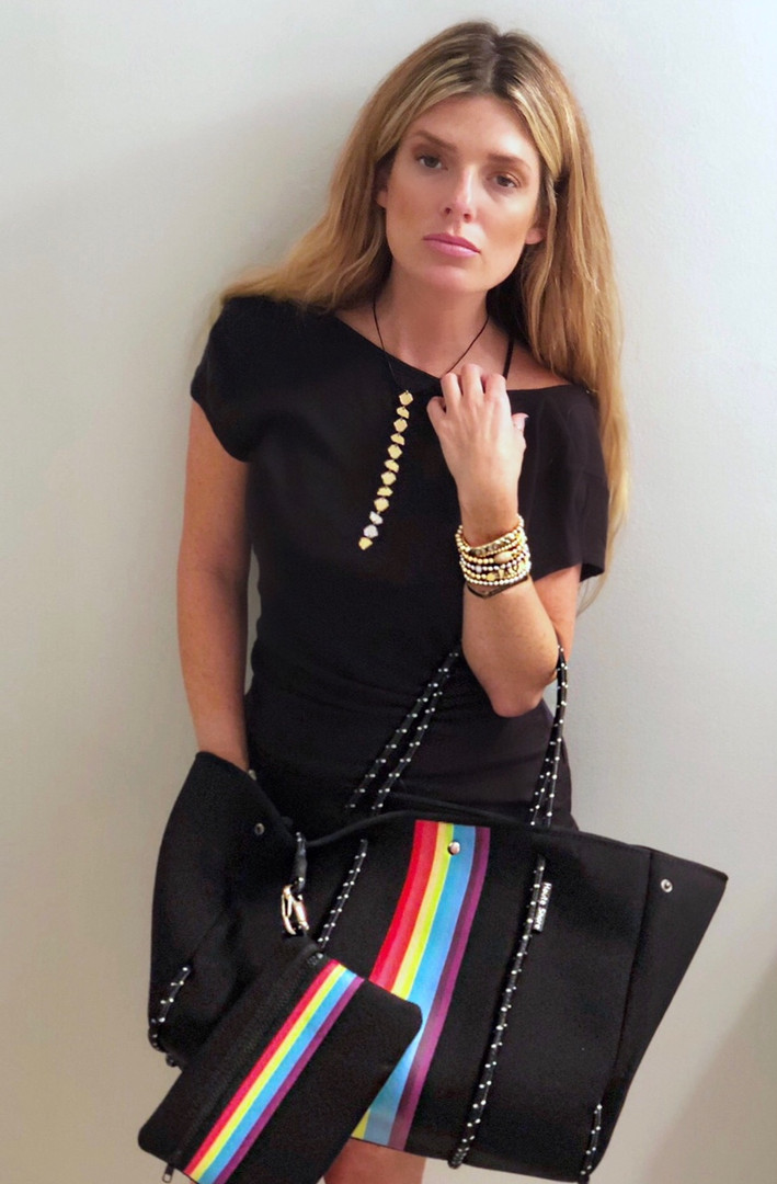 Leather/Gold necklace $95, Bracelets $18-$38, Neoprene tote w/pouch $89