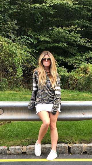 Camo sweatshirt $78; Distressed denim skirt $64
