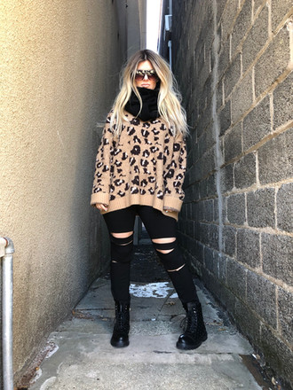 """Quay """"Drama By Day"""" sunnies $60; Knit pullover scarf $24; Combat boots $88"""