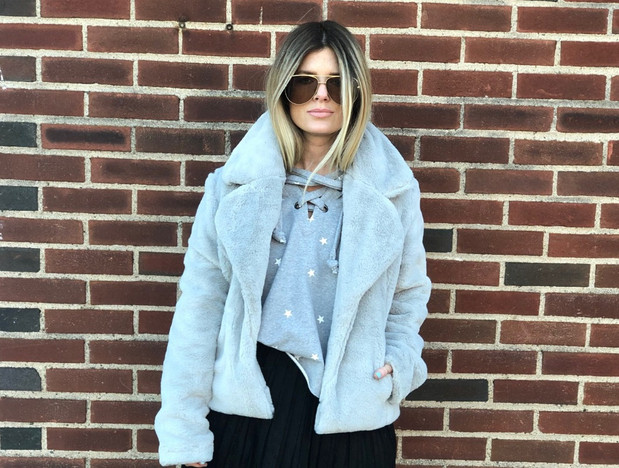 Faux fur jacket $88; Star sweatshirt $72