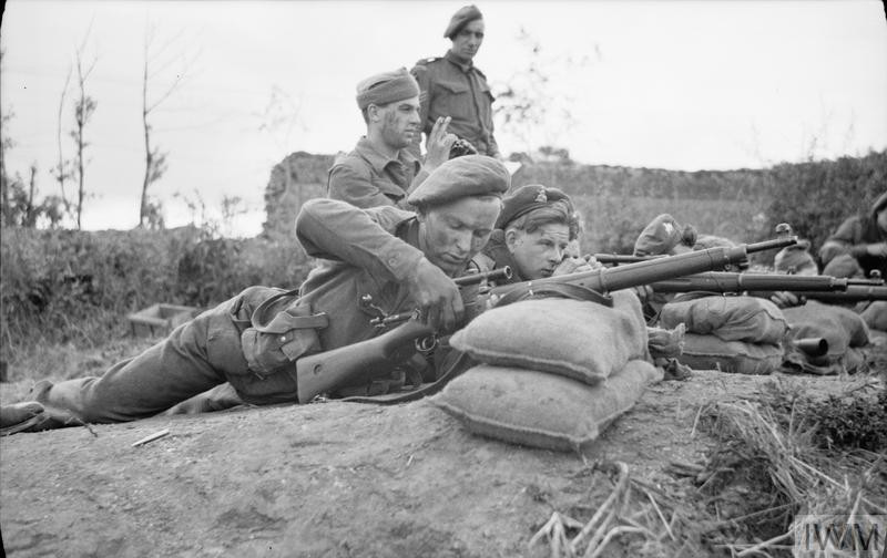 Snipers training at a sniper school in a French village, 27 July 1944. (Source: © IWM (B 8178))