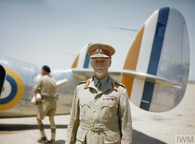 Field Marshal Jan Smuts standing in front of his personal transport aircraft, an ex-South African Airways Lockheed Lodestar, which he used to tour the North African front. (Source: © IWM (TR 5))