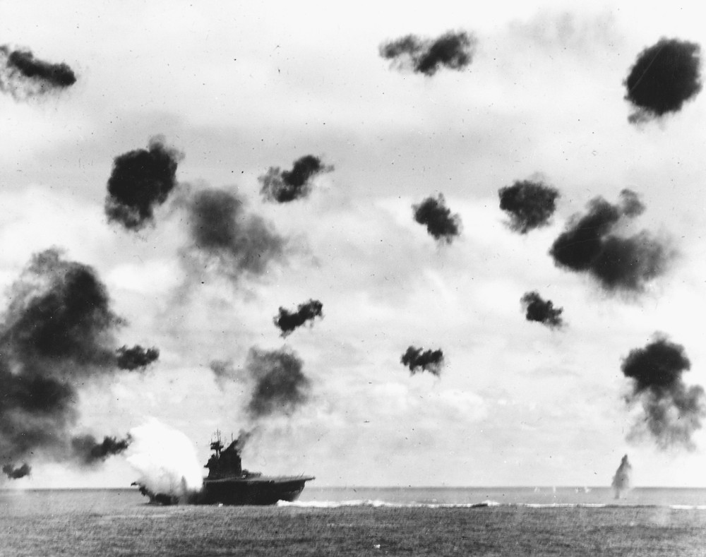 USS Yorktown (CV-5) is hit on the port side, amidships, by a Japanese Type 91 aerial torpedo during the mid-afternoon attack by planes from the carrier Hiryu, in the Battle of Midway, on 4 June, 1942.  (Source: Wikimedia)