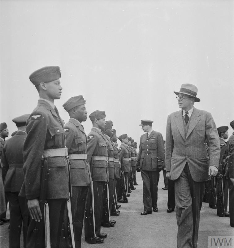 The Right Honourable Colonel Oliver Stanley MC, MP (Secretary of State for the Colonies) and Air Marshal Sir Arthur Barratt, KCB, (Air Officer Commanding in Chief Technical Training Command) inspect new West Indian recruits to the RAF. (Source: © IWM (D 21133))