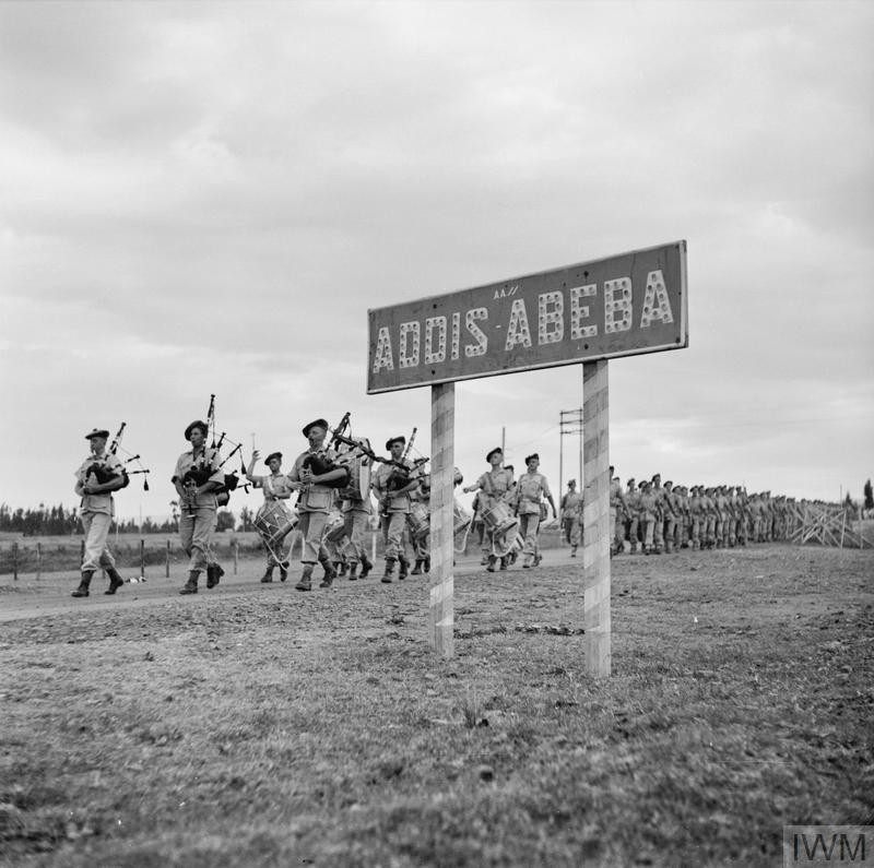 Troops of the Transvaal Scottish march through Addis Ababa. (Source: © IWM (E 2987))