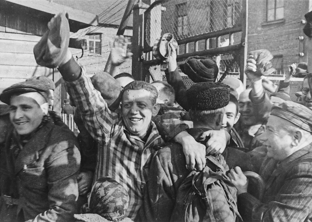 Prisoners of Auschwitz greet their liberators. (Source: United States Holocaust Memorial Museum, courtesy of Belarusian State Archive of Documentary Film and Photography)