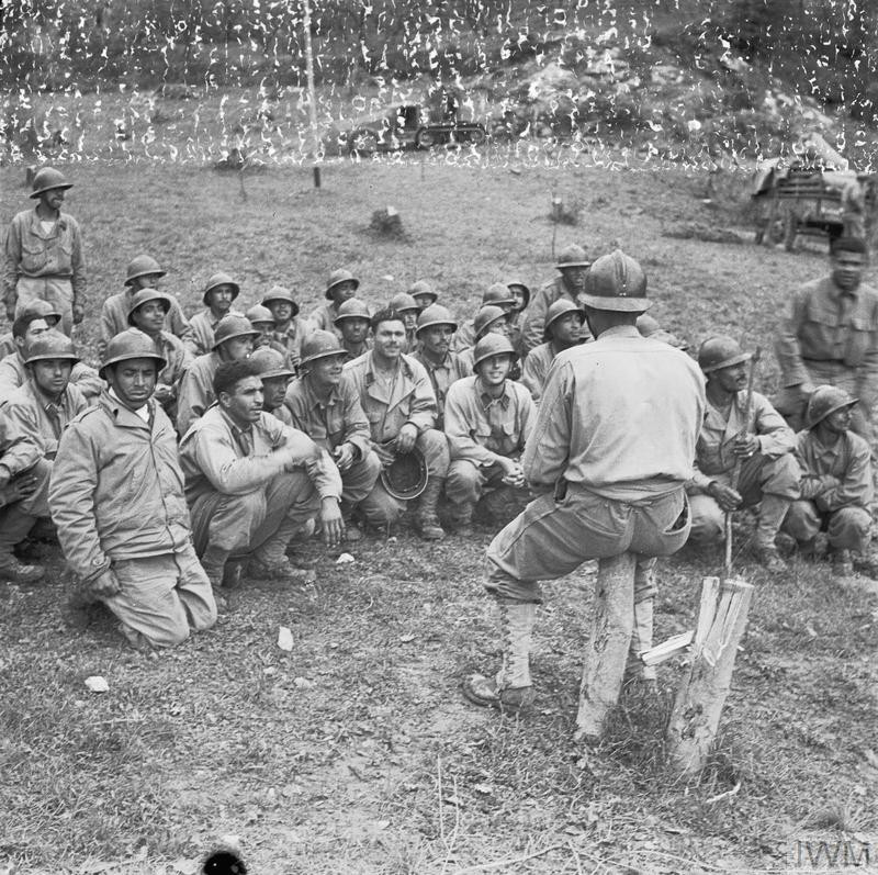 Infantry (known as Goums) of the 2nd French Moroccan Division receive a final briefing before relieving the 34th US Division in the front line near Cassino during the first phase of the battle. (Source: © IWM (NA 9734))
