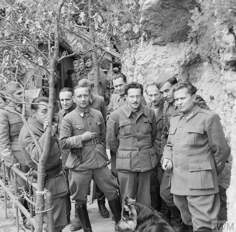 Marshal Tito stands with his Cabinet Ministers and Supreme Staff at his mountain headquarters in Yugoslavia on 14 May 1944. (Source: © IWM (NA 15129))