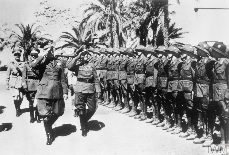 General Erwin Rommel, the Commander of the German Afrika Korps, inspects his troops with General Garibaldo of Italy shortly after their arrival in North Africa, 21-31 March 1941. (Source: © IWM (HU 39482))