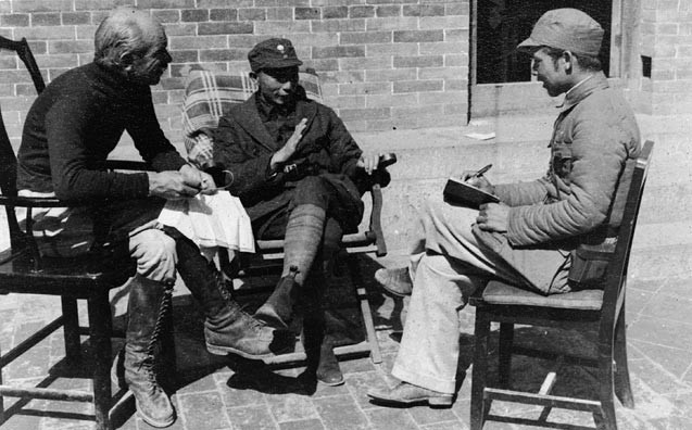 Norman Bethune in China with Nie Rongzhen (centre) and an interpreter, 1938. (Source: Wikimedia)