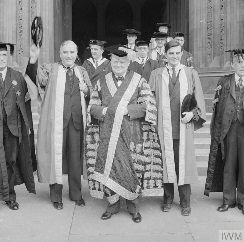 British Prime Minister Winston Churchill, American Ambassador to London John Winant, and Australian Prime Minister Robert Menzies after a ceremony at Bristol University on 12 April 1941 where Churchill, as Chancellor of the university, presented degrees of Doctors of Laws to the two men. (Source: © IWM (H 8856))