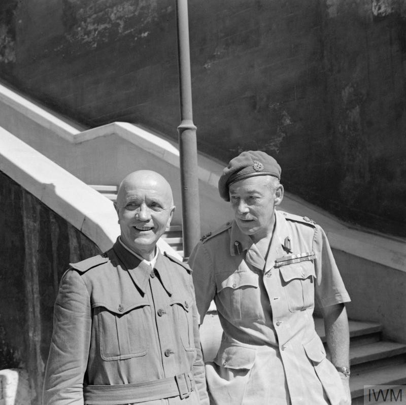 The first Prime Minister of Italy after the fall of Mussolini, Field Marshal Pietro Badoglio with the Head of the Military Mission in Brindisi, Lieutenant General Sir Noel Mason-MacFarlane. Photograph taken at the Italian Naval Headquarters at the Castle, Brindisi. (Source: © IWM (NA 7029))