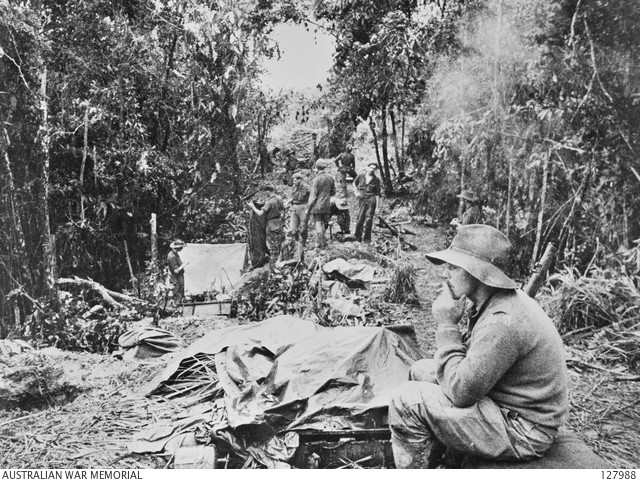 Members of 2/3rd Australian Independent Company make camp after their successful attack on 'Timbered Knoll', Orodubi, New Guinea, 30 July 1943. (Source: Australian War Memorial)