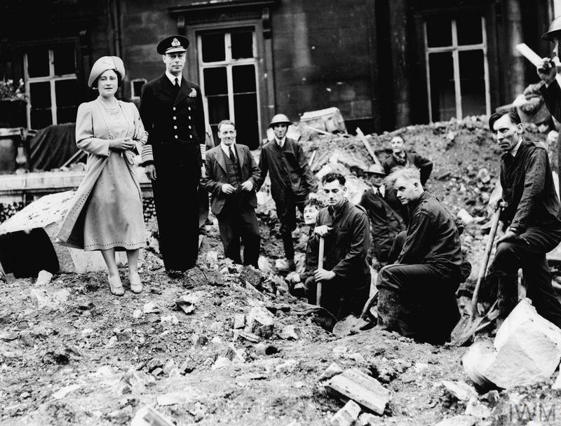 King George VI and Queen Elizabeth standing with workmen, while inspecting bomb damage at Buckingham Palace. (Source: © IWM (HU 63234))