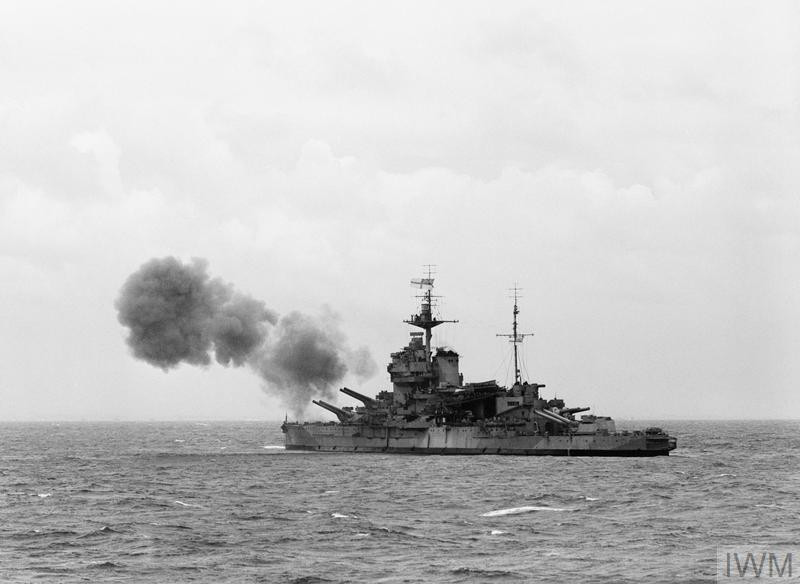 HMS Warspite, part of Bombarding Force 'D' off Le Havre, shelling German gun batteries in support of the landings on Sword area, 6 June 1944. The photo was taken from the frigate HMS Holmes which formed part of the escort group. (Source: © IWM (A 23916))