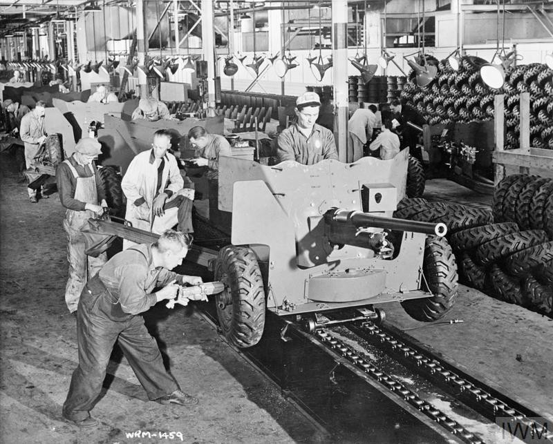 Anti-tank guns being assembled on the production line at a Canadian armaments factory, 1943. (Source: © IWM (CAN 2624))